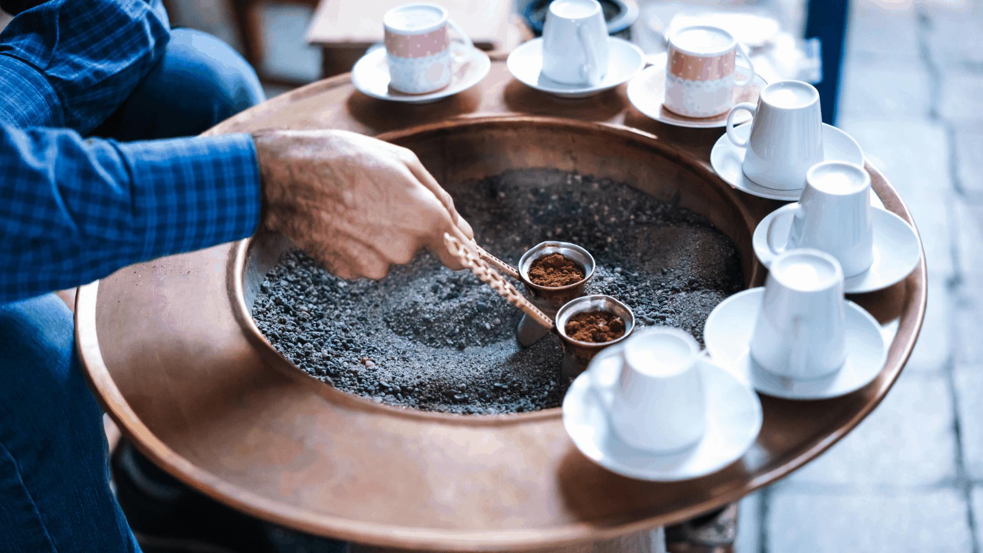 man making turkish coffee